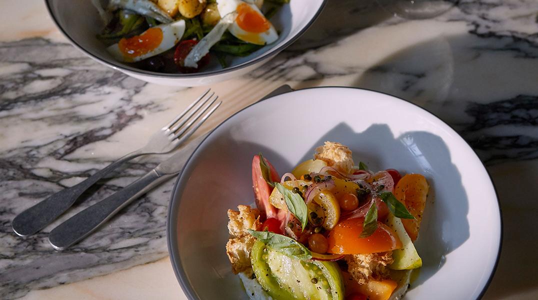 Salade niçoise and heritage tomato panzanella salad